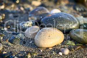 Sea stones by the sea. Reference picture