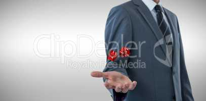 Composite image of midsection of sophisticated businessman offering