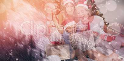 Composite image of happy family at christmas opening gifts together