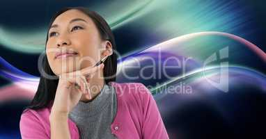 Woman looking up casually with colorful curves background