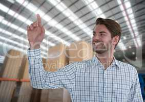 Businessman touching air in front of warehouse