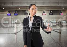 Airport businesswoman touching air in front of airport queue barriers