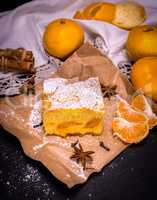 piece of tangerine cake on brown kraft paper