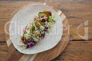 Mexican taco on wooden tray