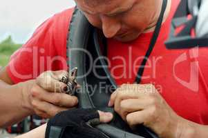 man repairing a Bicycle wheel, a replacement Bicycle camera