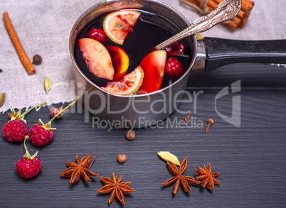 mulled wine in an aluminum ladle with a handle