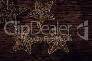 Handmade stars on wooden plank