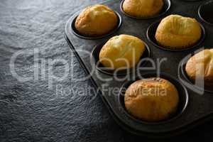 Plain cupcakes on baking tray