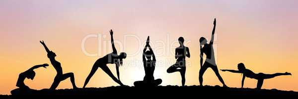 yoga group silhouette at sunset