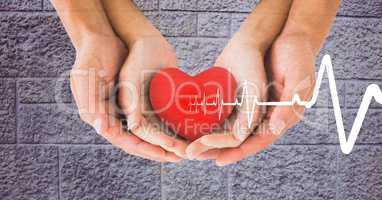 Heart beat over hands holding heart