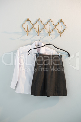 Formal shirt and skirt hanging on hook