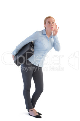 Businesswoman with a briefcase listening to the gossip