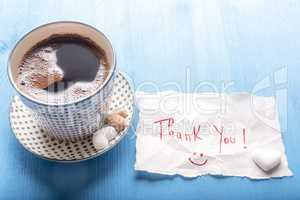 Coffee cup and cute thank you note