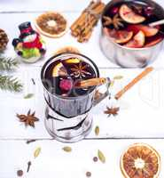 mulled wine in a glass with an iron cup holder