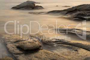 Beautiful sunrise in a bay with rocks in Costa Brava (Catalonia)