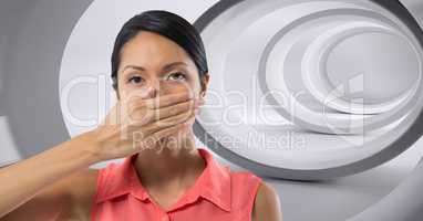 Woman holding hand over mouth in tunnel