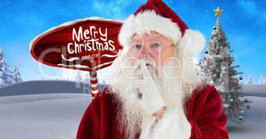Merry Christmas text and Santa hushing quietness with Wooden signpost in Christmas Winter landscape