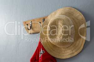 Dress and hat hanging on hook
