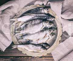 dried salted fish ram in an iron plate