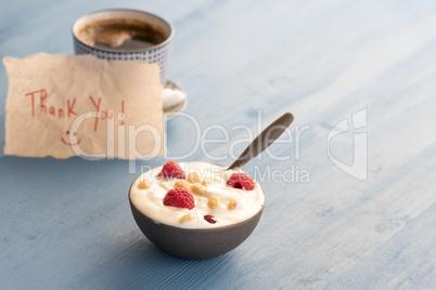 Yogurt with raspberry in a bowl