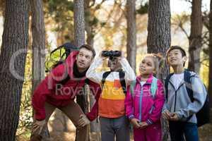 Teacher and kids exploring in park