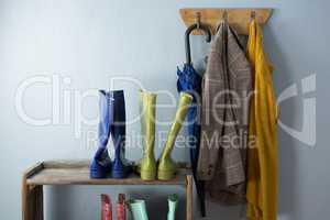 Wellington boots, umbrella and blazer on hook