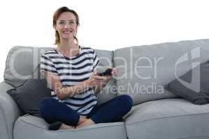 Woman playing video game against white background