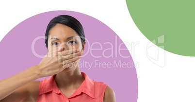 Businesswoman with minimal shapes putting hand over mouth