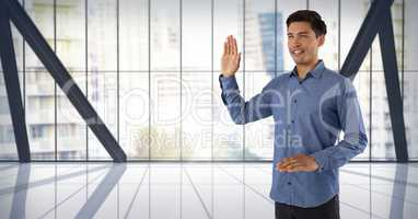 Businessman swearing honesty with hand in city office