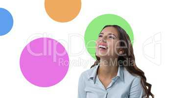 Businesswoman laughing with colorful circles