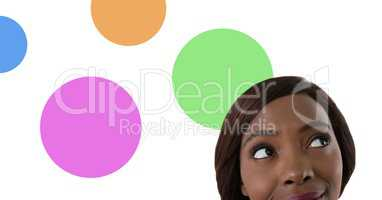 Woman looking up with colorful circles