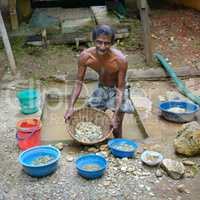 Sri Lanka - November 29, 2013: Unskilled worker at the mine for