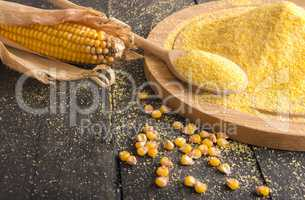 Corn cob and flour spread on table
