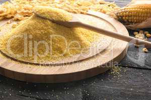 Pile of corn flour on a wooden board