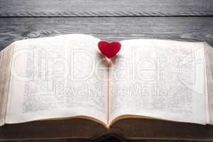 Red heart on an open book