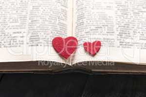 Two hearts on the pages of a book