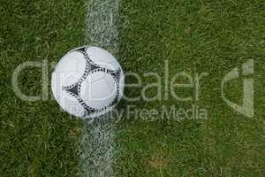 Soccer ball on white marking line