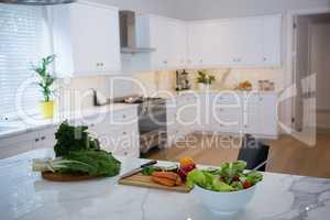 Various fresh vegetables on kitchen worktop