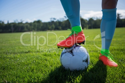 Football player standing with soccer in the ground