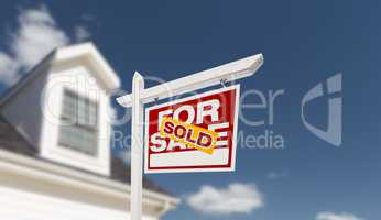 Sold Home For Sale Real Estate Sign in Front of Beautiful New Ho