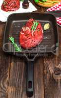 piece of raw beef with spices