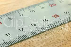 A fragment of metal measuring ruler.