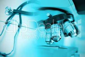 Composite image of stethoscope on desk