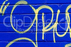 Grunge blue brick background with abstract yellow pattern.