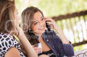 Expressive Young Adult Girlfriends Using Their Smart Cell Phone