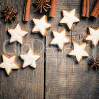 Sweet cinnamon stars on a wooden table with space for text