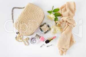 Cosmetics, perfumes, jewelry made of pearls and handbag