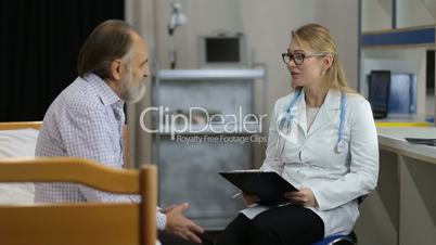 Physician telling good medical results to patient