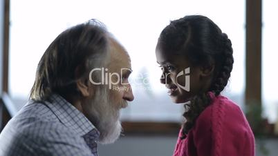 Positive grandpa telling funny story to grandchild