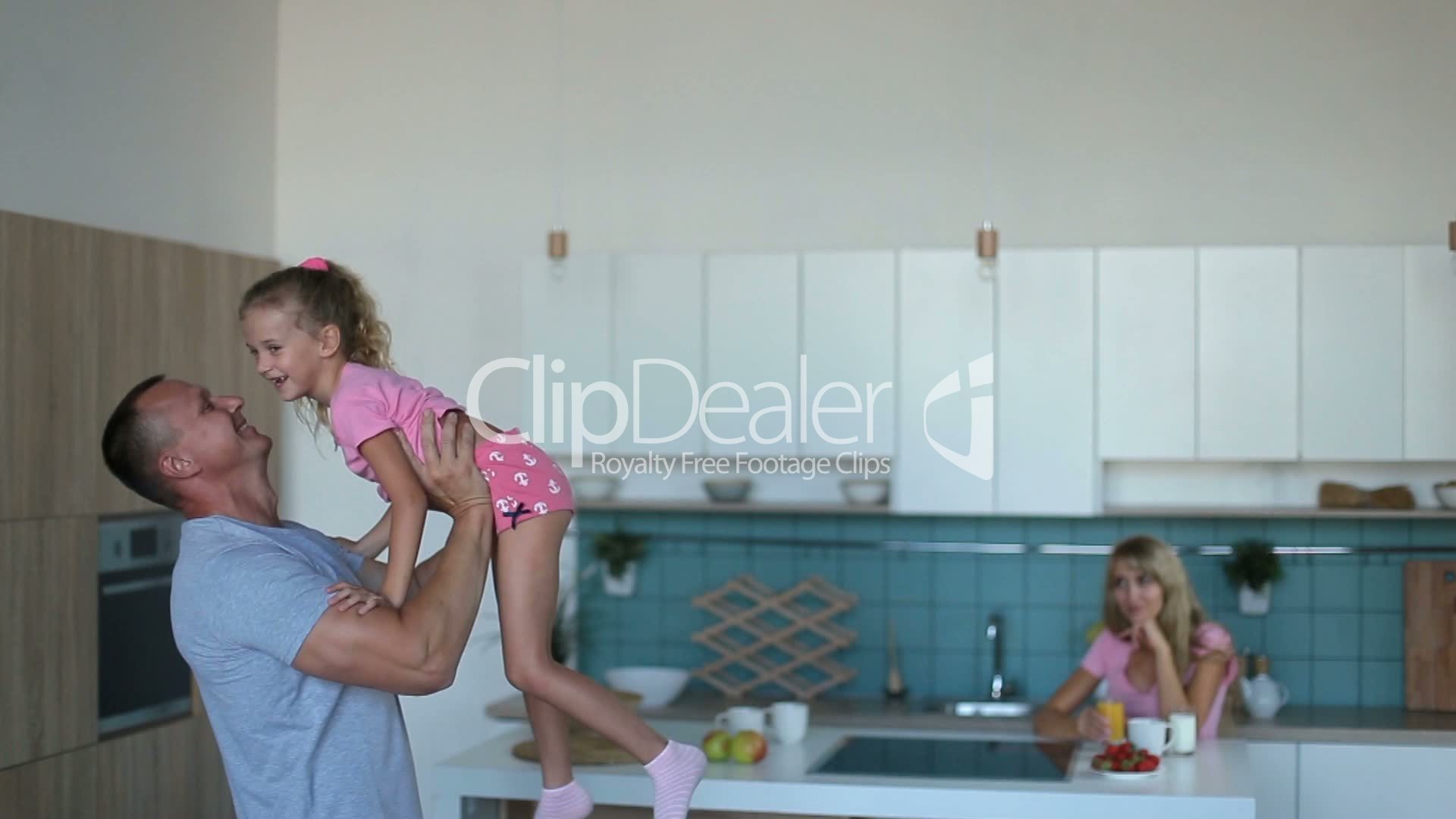 Affectionate dad raising daughter up in the kitchen: Royalty-free ...